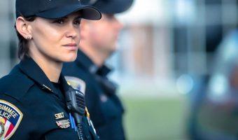 police woman using digital two-way radio